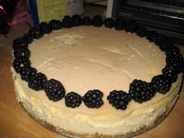 Traditional Cheesecake topped with fresh blackberries