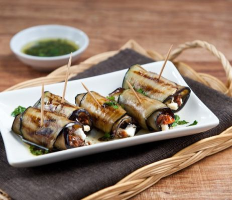 Grilled aubergine rolls stuffed with sun-dried tomatoes and feta cheese