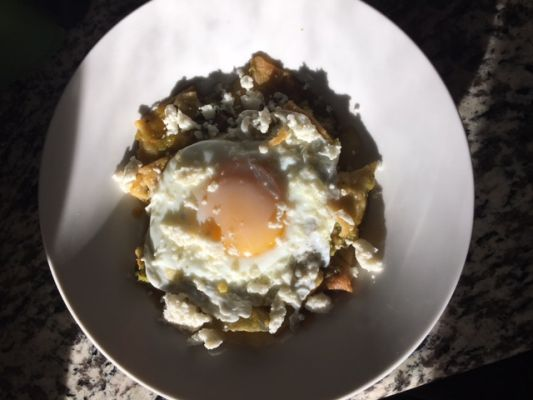 Chilaquiles with a sunny side up egg, Delicious for breakfast.