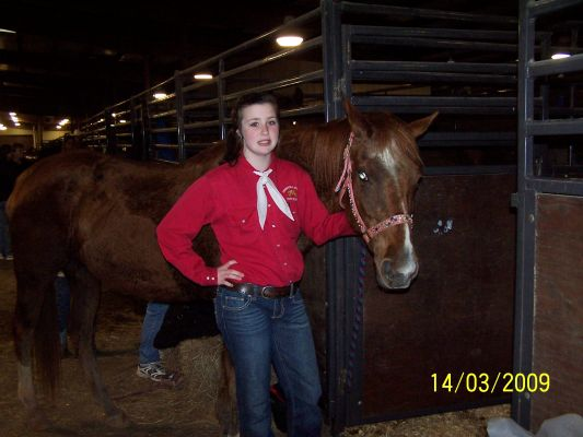 My daughter, Jordan and her horse, BB at the stalls after their rodeo ride.