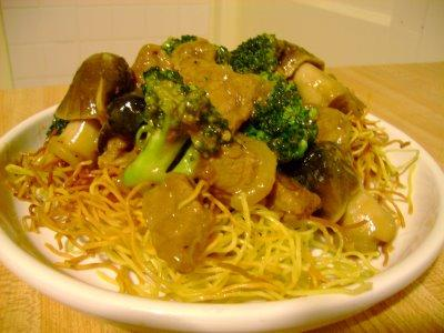 Beef Broccoli Over Hong Kong Pan Fried Noodles