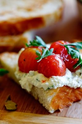 Marinated cherry tomatoes with whipped ricotta on Sourdough