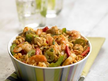 Spicy mexican rice with chicken and tiger prawns