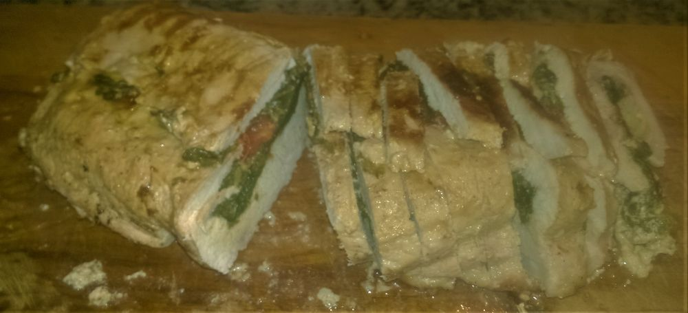 Roast Pork Loin stuffed with Spinach, Heirloom cherry tomatoes, and Gouda