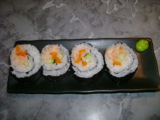 my first try at rolling sushi....I was too scared to try it with expensive fresh fish, so I used canned tuna mixed with spicy chili sauce. Not bad....