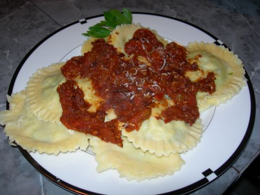 Home made ravioli! Filled with spinach and ricotta cheese, scratch sauce with roma and sun-dried tomato.