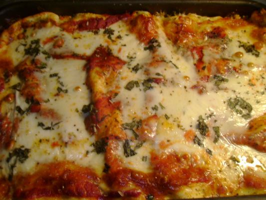 My lasagna!!! Totally from scratch--the sauce, the noodles, not one thing came from a box. Instead of ground beef I use a mix of sweet and hot Italian sausage. I mix cooked spinach in with the ricotta and toss in loads of fresh basil.
