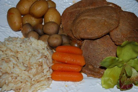 Roast Beef with potatoes, mushrooms, carrots, & rice pilav on the side