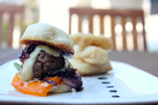 JAPANESE KOBE SLIDERS IN CHINESE BAO WITH BRIE, FIG JAM, AND CARAMELIZED ONIONS