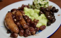 Roasted pork sausages with grapes
