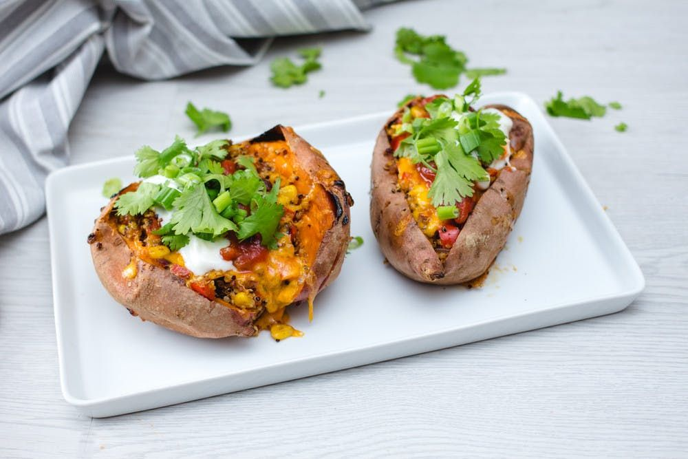 Stuffed Mexican Sweet potatoes With Arugula Salad