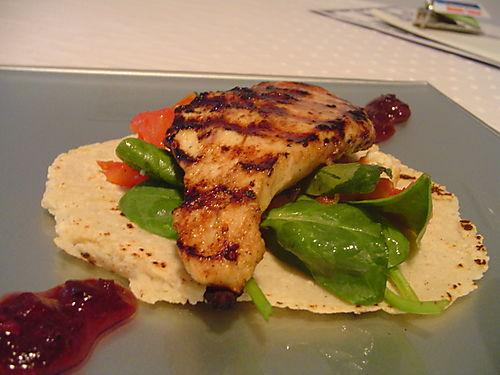 Orange-cumin chicken with blueberry chipotle sauce