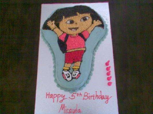 Micayla turned 6, but she didnt care it was a Dora cake