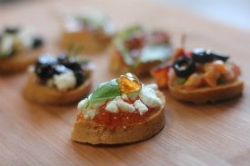 Gluten-Free Red Pepper Jelly Crostini with Goat Cheese and Basil