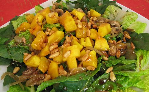 Pumpkin salad with warm onions and mushrooms