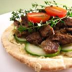 Pita topped with hummus and lamb