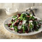 Broccoli salad with raisins, pumpkin seeds and yoghurt sauce