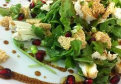 Arugula salad with pasteli and pomegranate